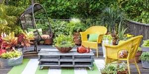 A tidy, well organised back garden with seating area.